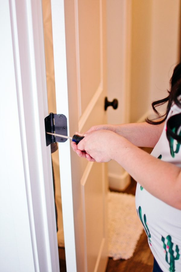 Woman uses her new homeowner checklist to fix small problems quickly.