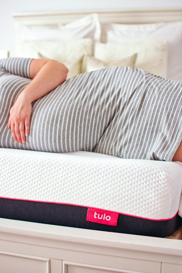 A mom to be on her tulo mattress.