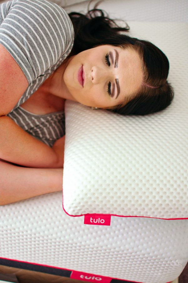 Woman getting sleep while pregnant on tulo mattress.