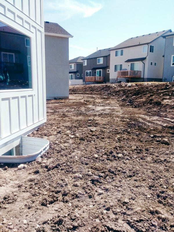 A picture of the before landscaping for a backyard.
