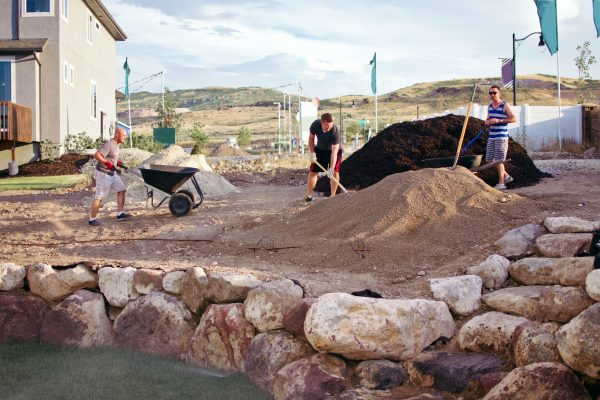 Workers terracing a sloped backyard