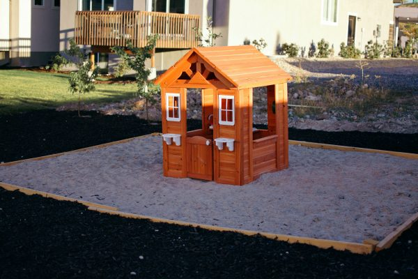 A DIY sandbox is a cheap and simple landscaping idea.