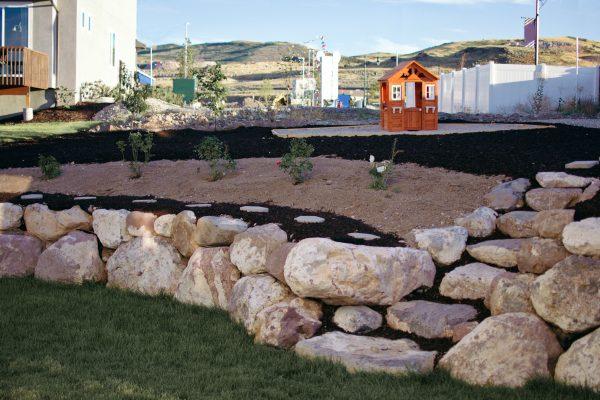 sloped backyard retaining wall