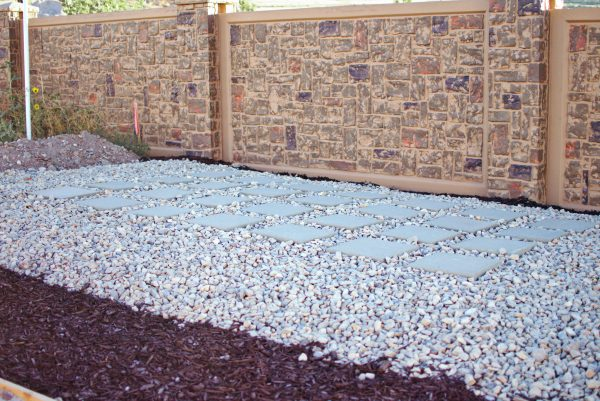 Rocks and mulch are great for a backyard transformation on a budget