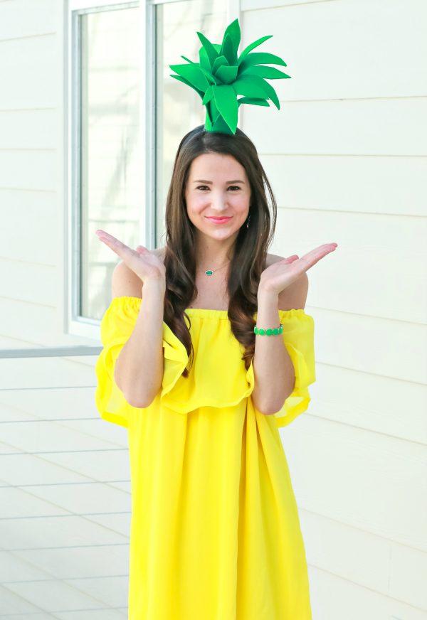 Woman wears DIY pineapple costume for Halloween.