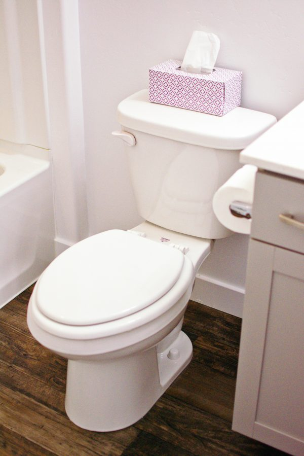 A white toilet in a bathroom.