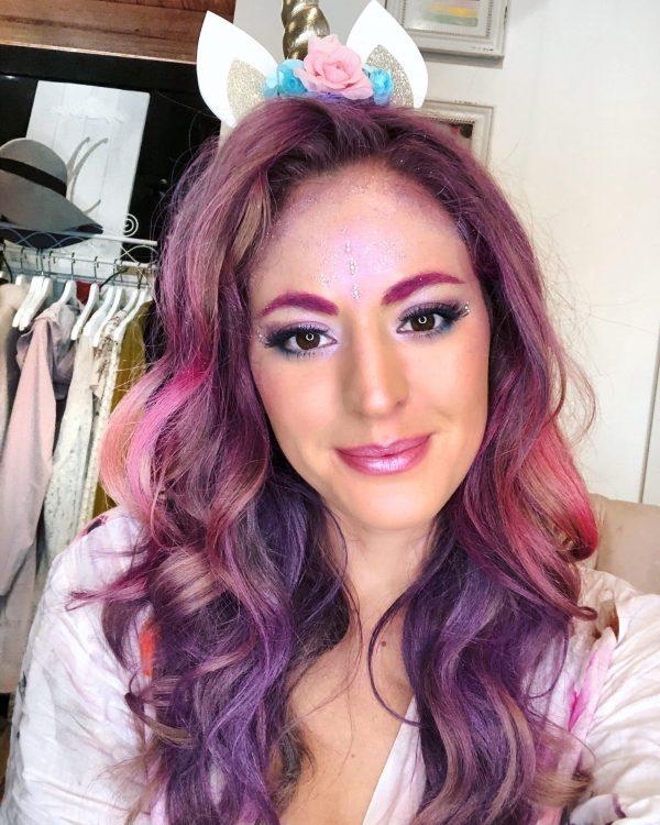 Woman shows her unicorn makeup tutorial.