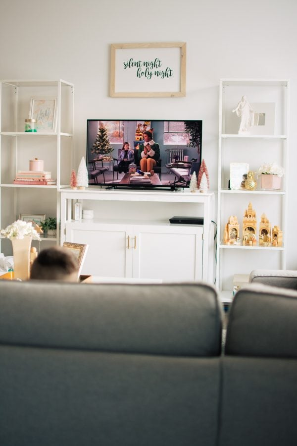 Boy watches Christmas classics on the TV.