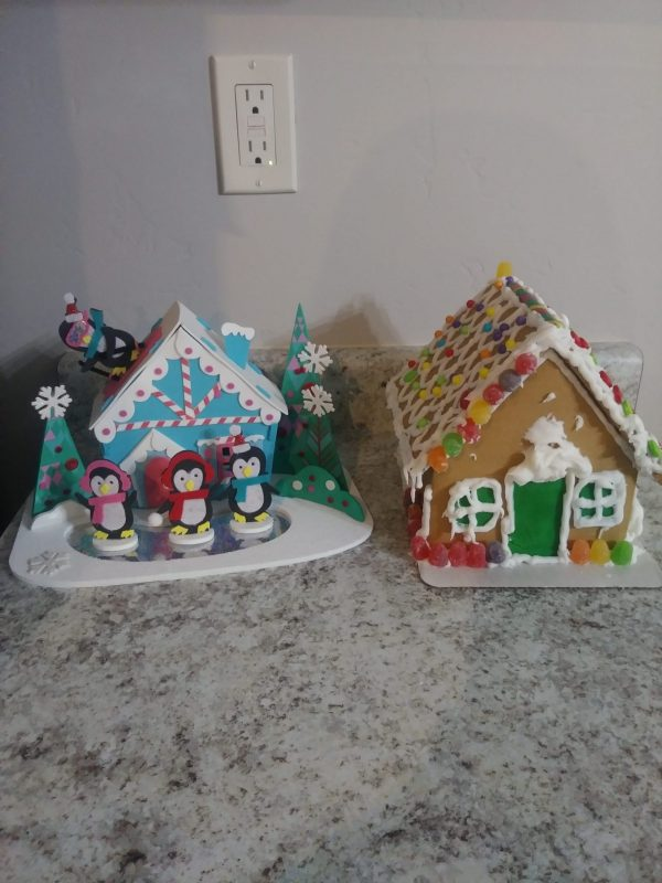 Decorating a gingerbread house is a fun family Christmas tradition.