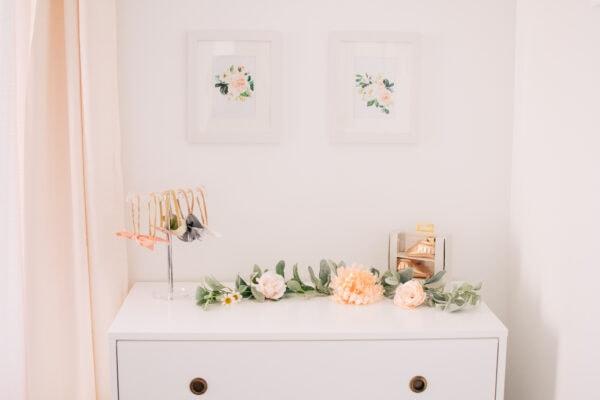 White dresser with flower decor.