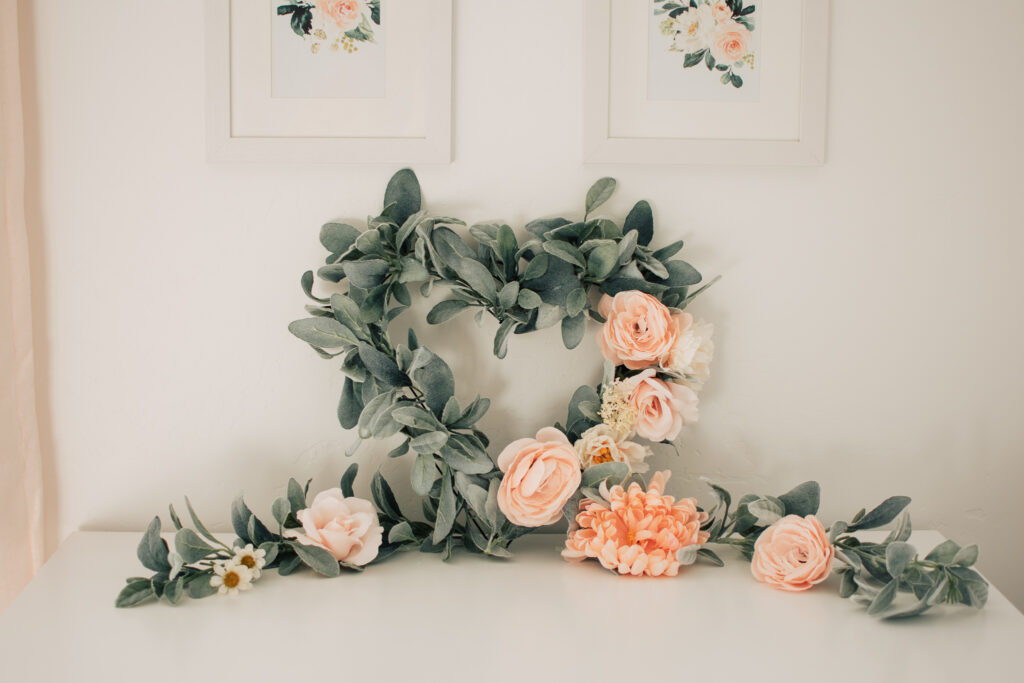 A DIY Valentines Day wreath sits on a dresser.