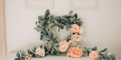 A DIY Valentines Day wreath sits on a dresser.
