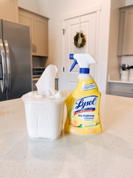 Homemade disinfectant wipes sit on a counter next to Lysol cleaner.