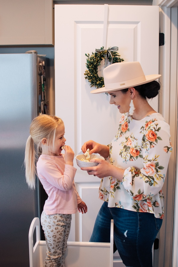 Mom and daughter eat Easter dessert for kids.
