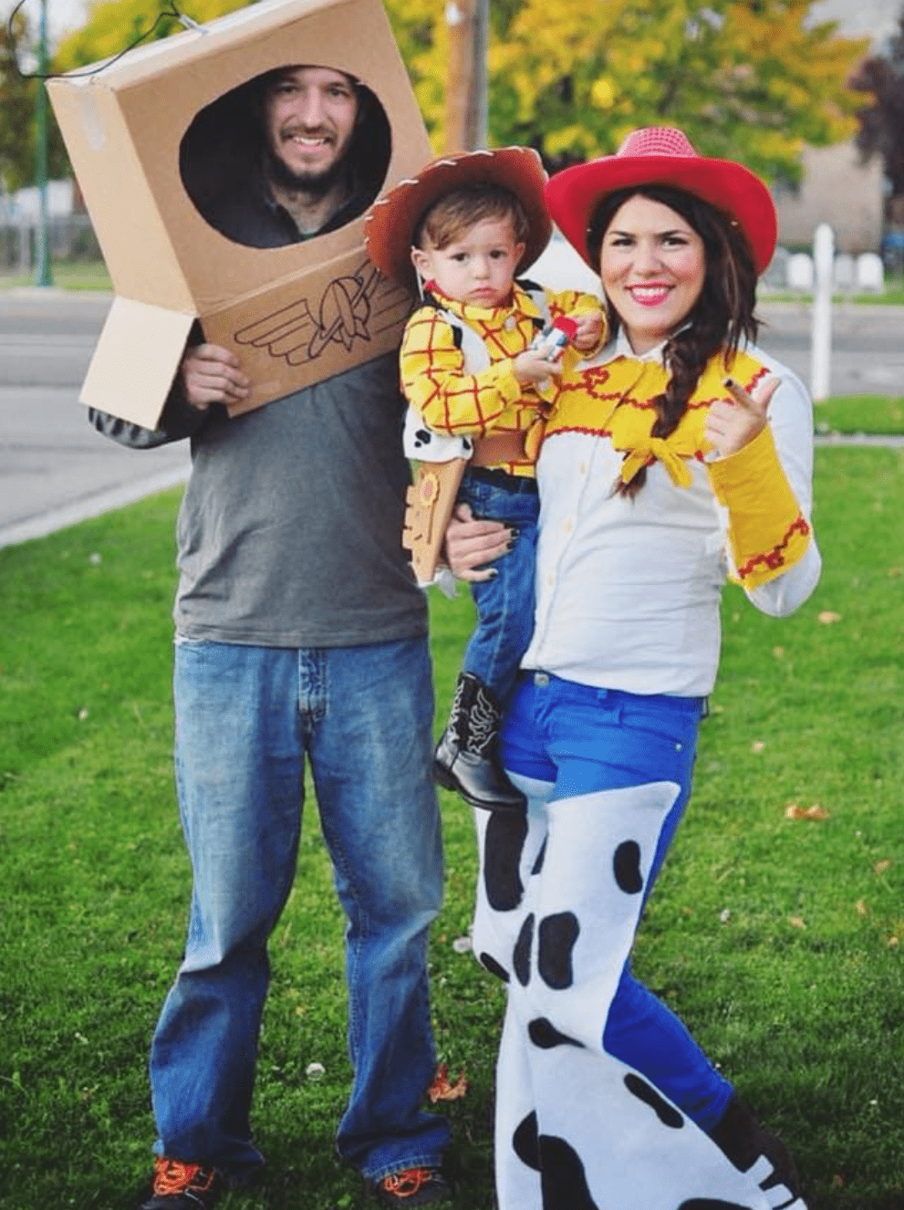 Family poses in matching Halloween costumes.