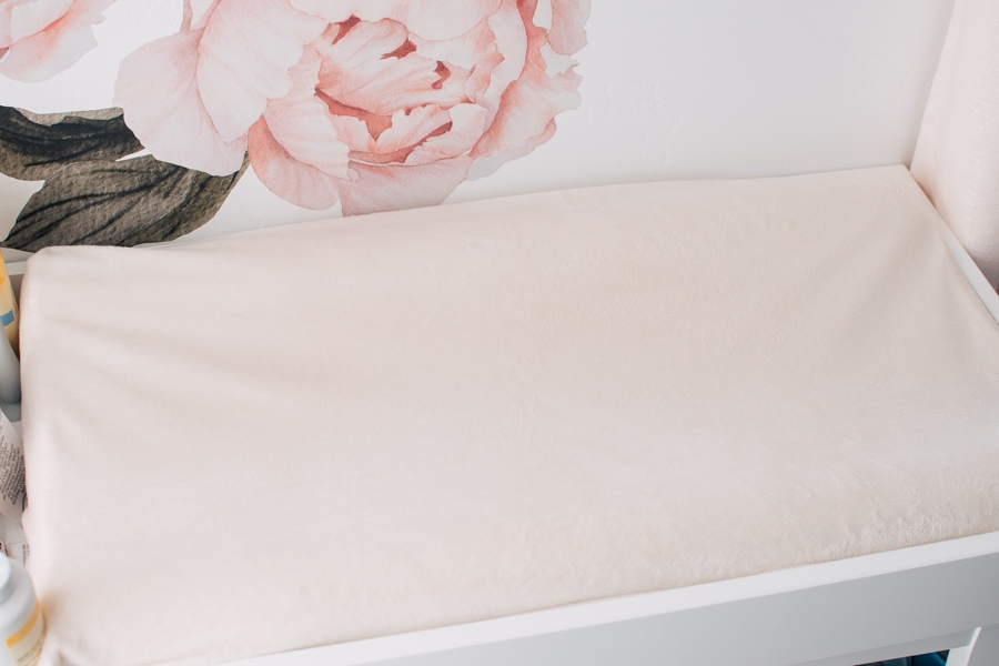 Changing pad and cover on a table.