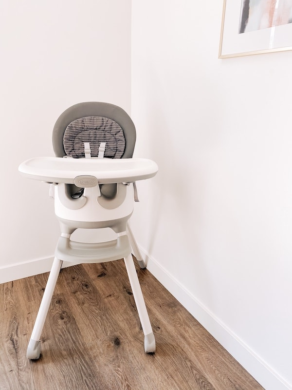 High chair in a dining room.