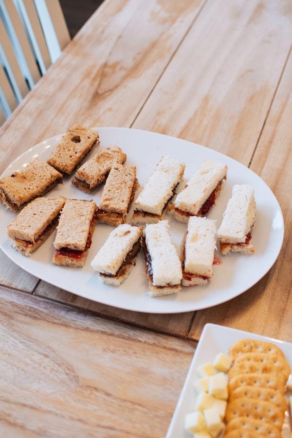 Finger sandwiches on a platter.