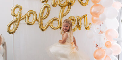 Girl twirls around on fourth birthday.