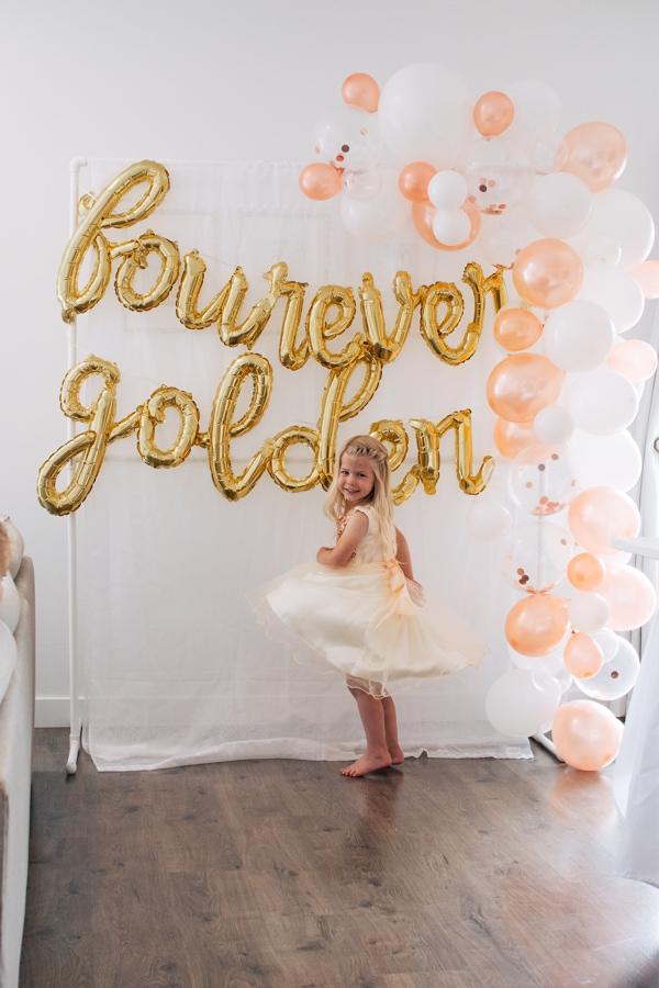 Girl twirls around on fourth birthday.