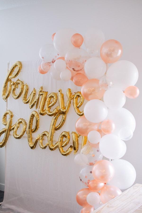 Golden birthday balloon garland.