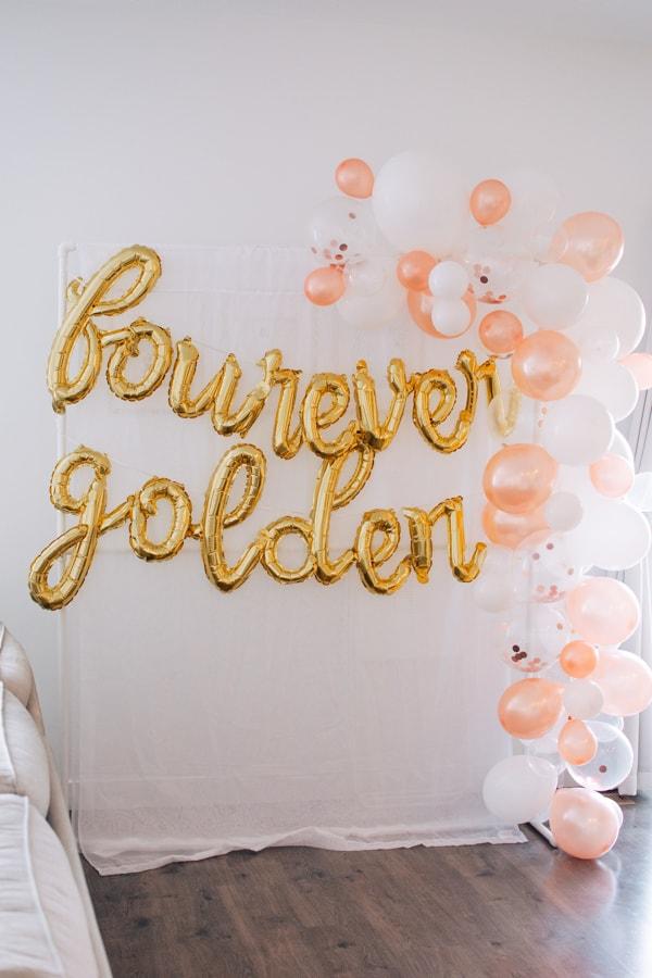 Golden birthday balloons on display.