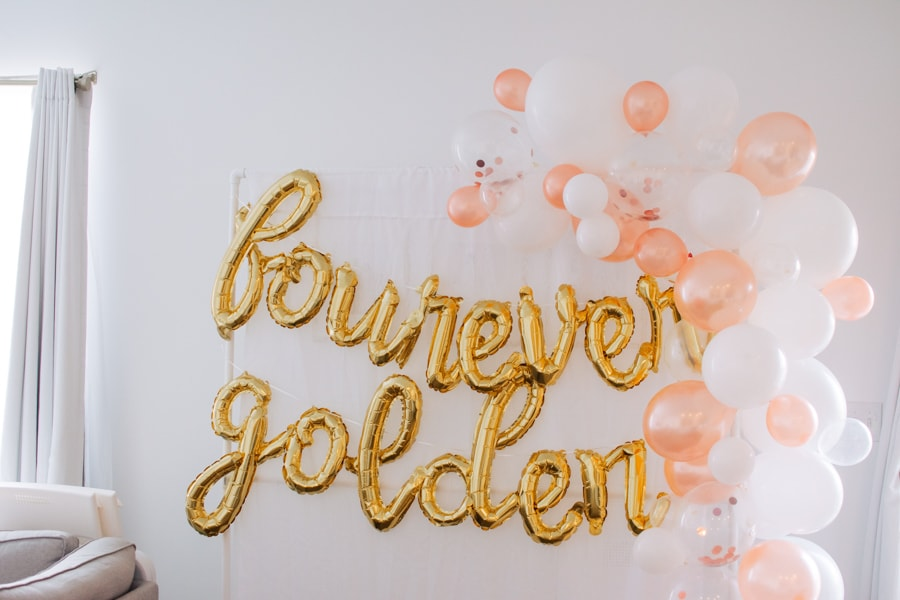 Golden birthday banner hung on a backdrop.