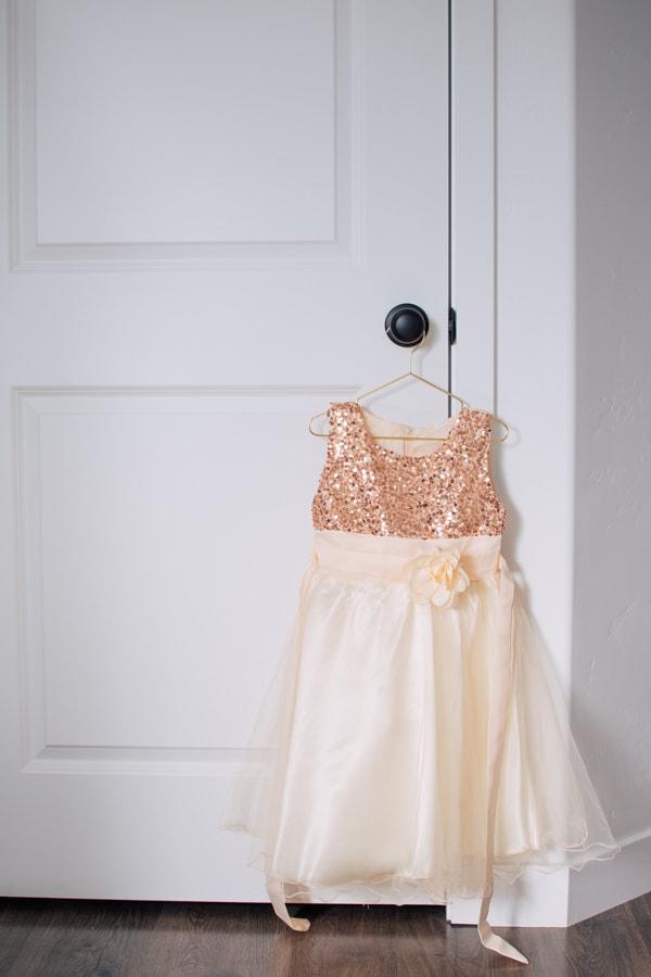 Golden birthday dress hung on a door knob.