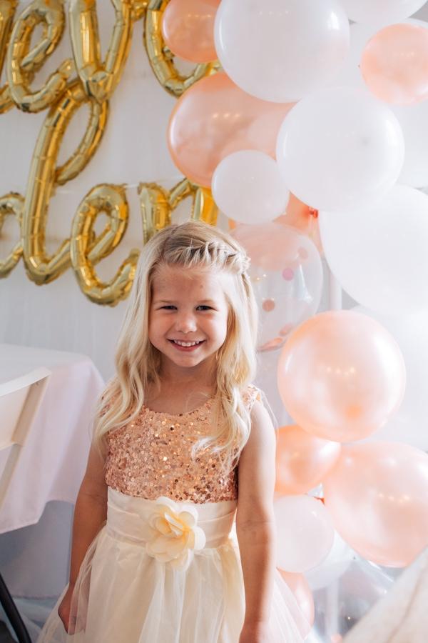 Golden birthday girl smiles.