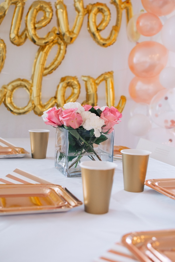Gold table settings at a birthday party.