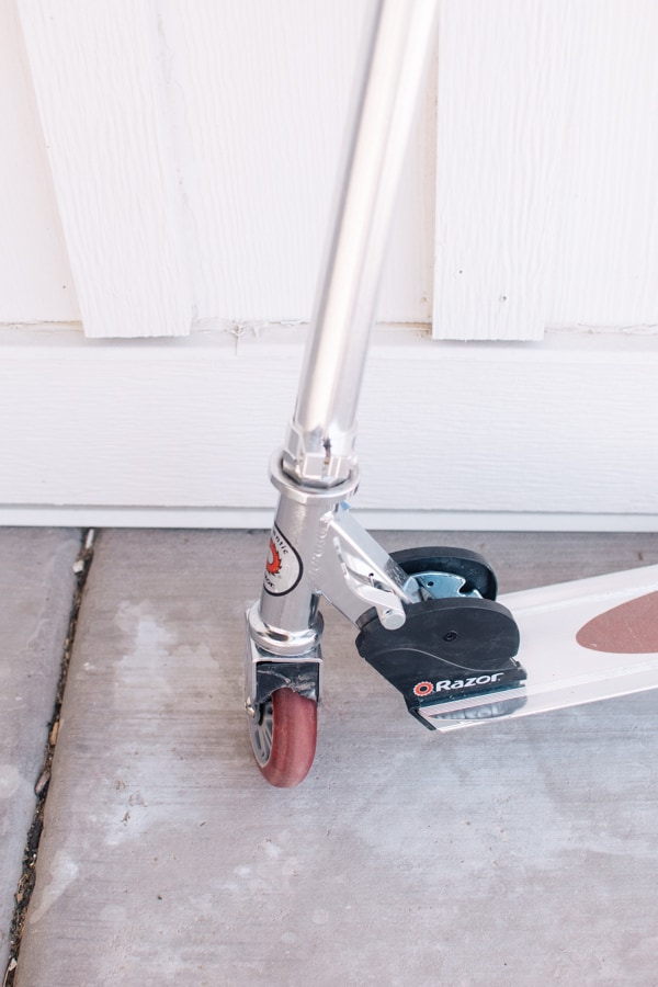 Damaged scooter on front porch.