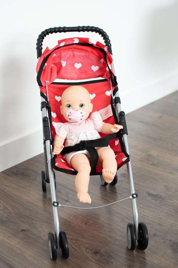 Baby doll in a doll stroller.