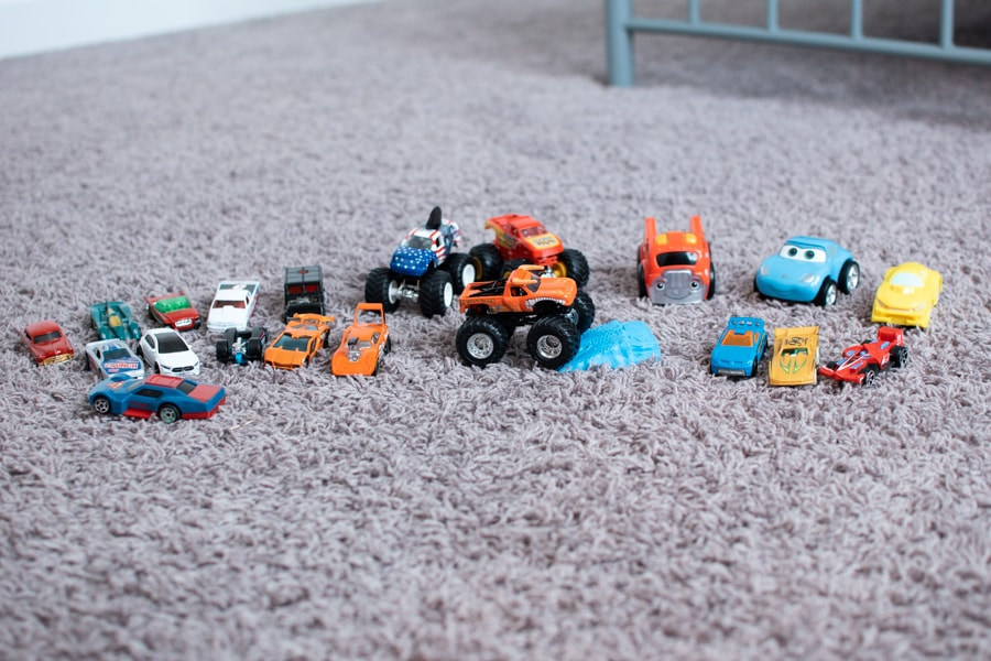 Several toy cars lined up to play.
