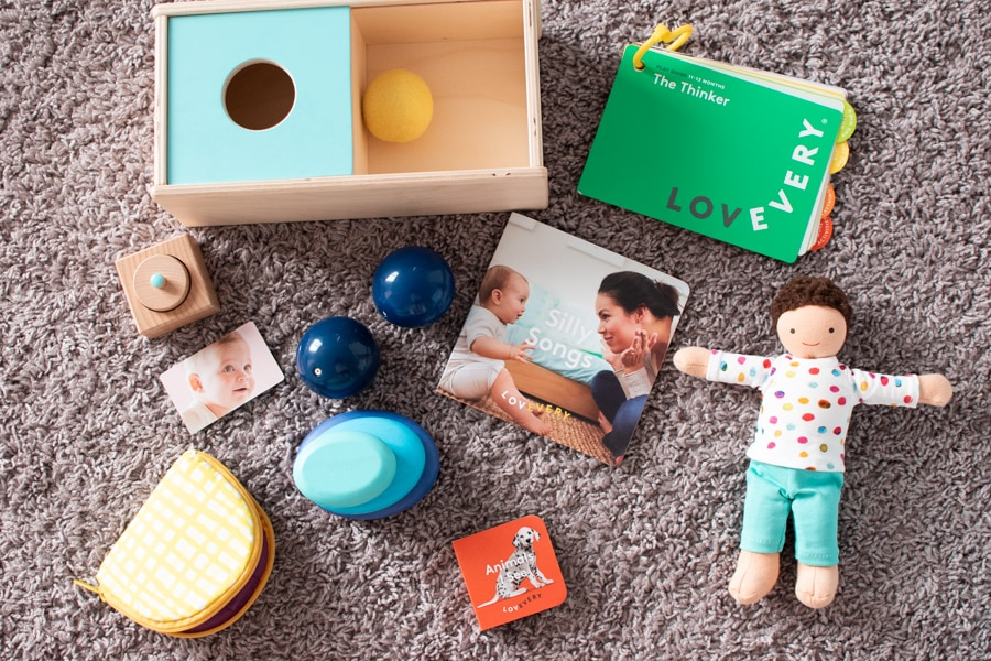 Contents of a Lovevery play kit on the floor.