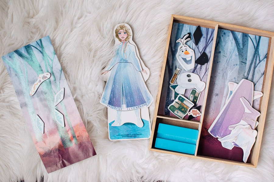 Elsa magnet doll on a white rug.