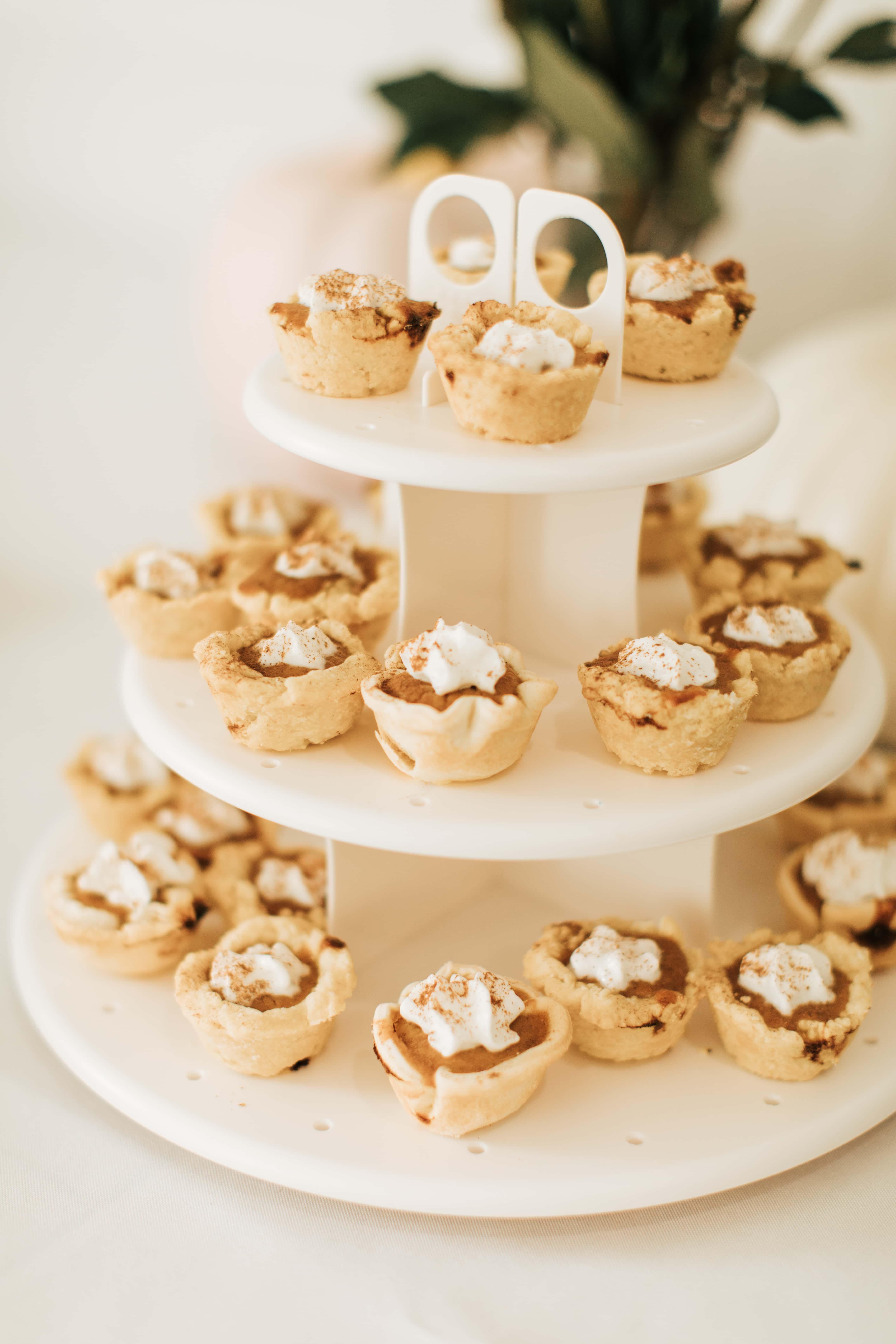 Mini pumpkin pies on a tiered tray.