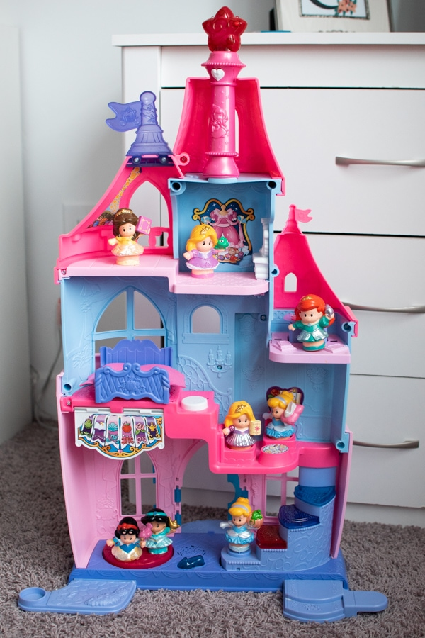 Little People princess castle in a room.