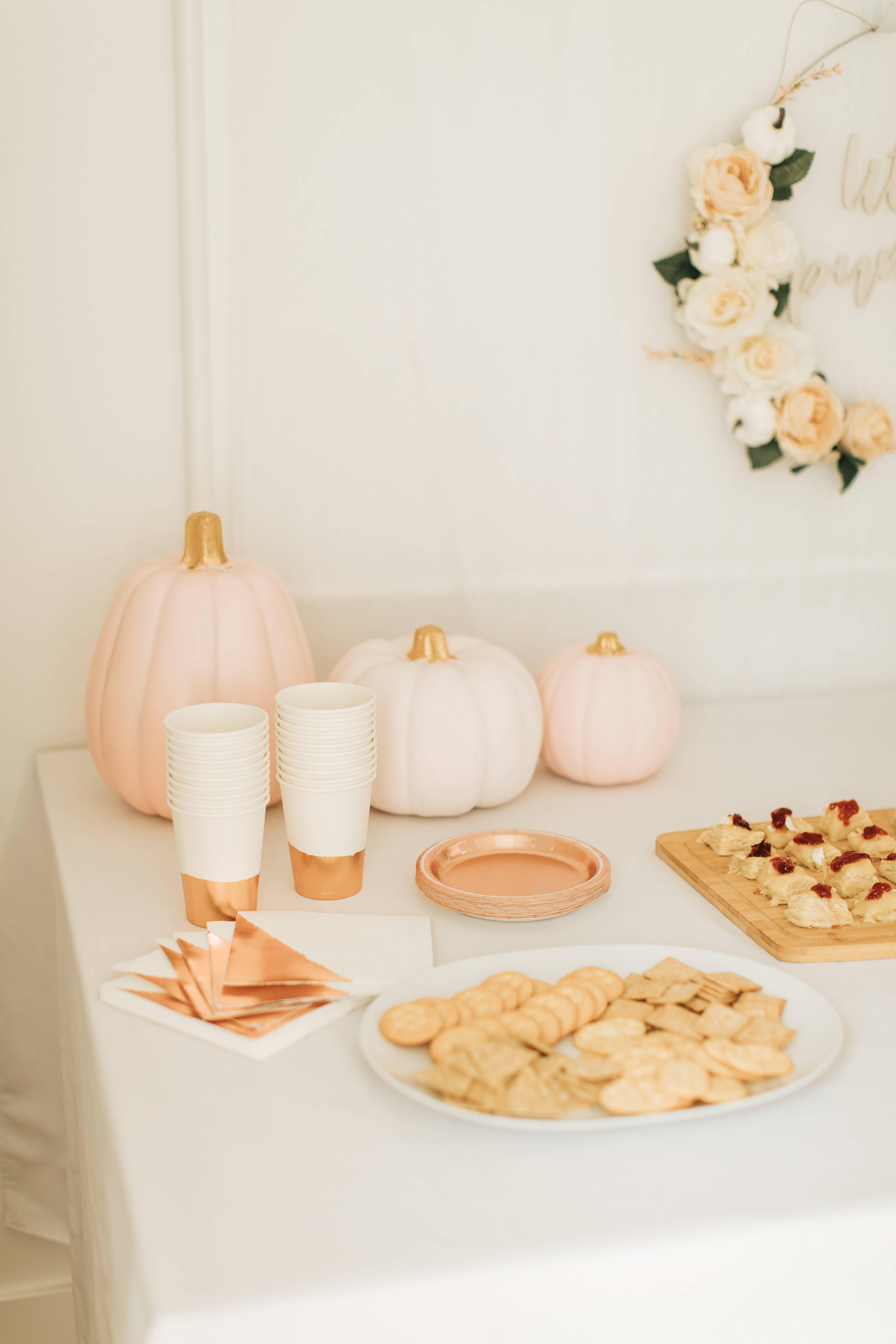Pumpkin themed first birthday tableware.