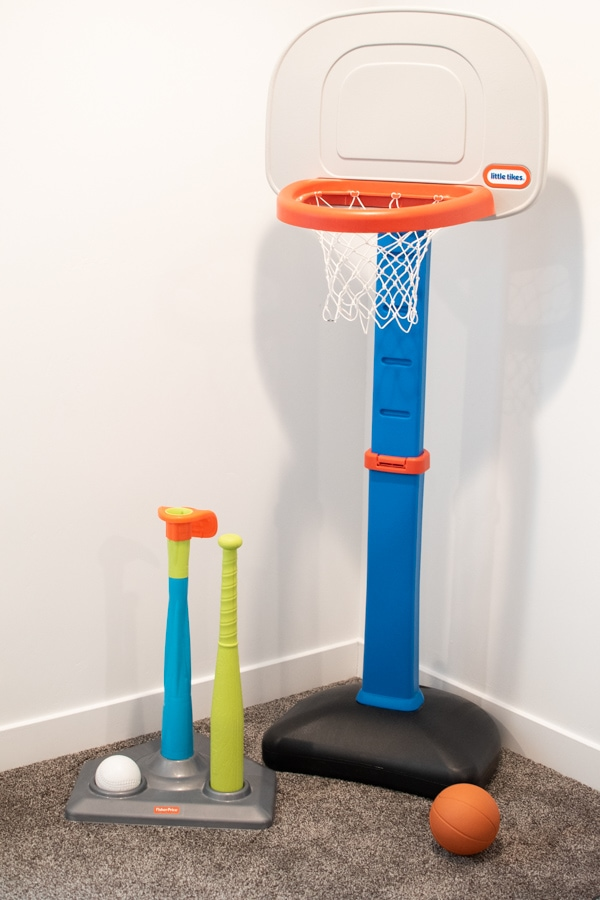 Sports toys standing in a basement.