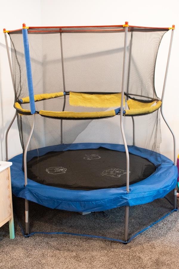 Mini trampoline in a basement.