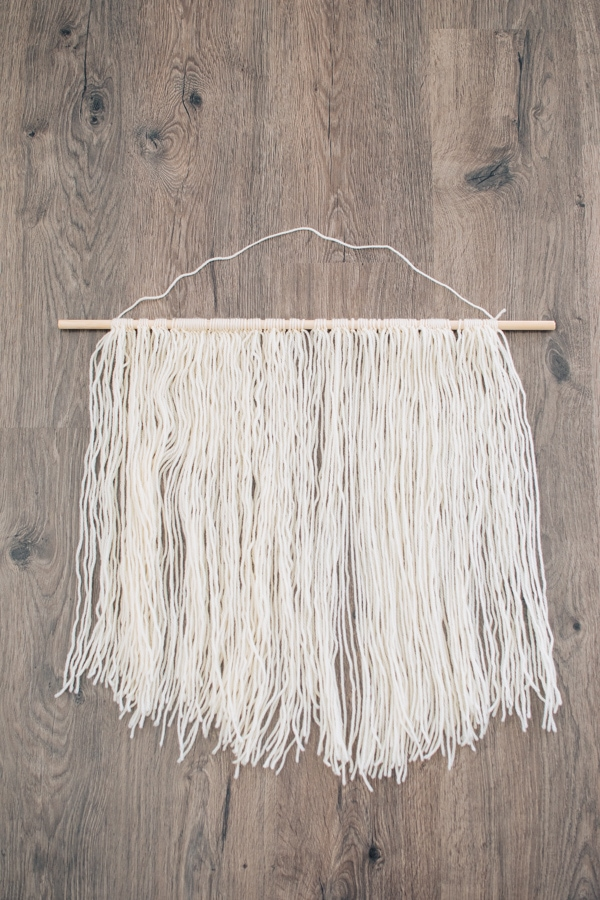 Yarn wall hanging on the floor
