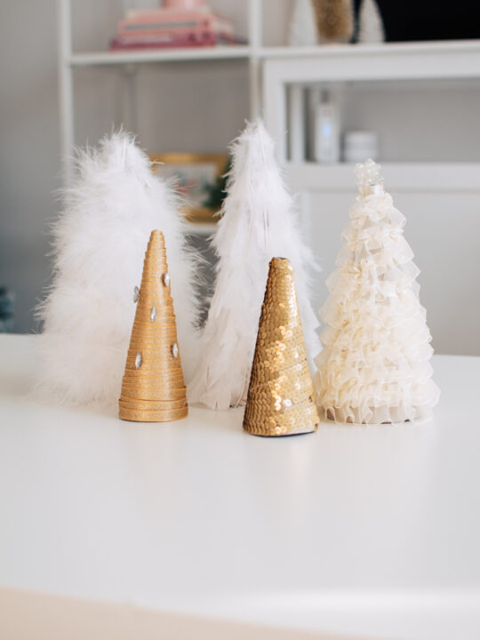 DIY cone Christmas trees on a table.