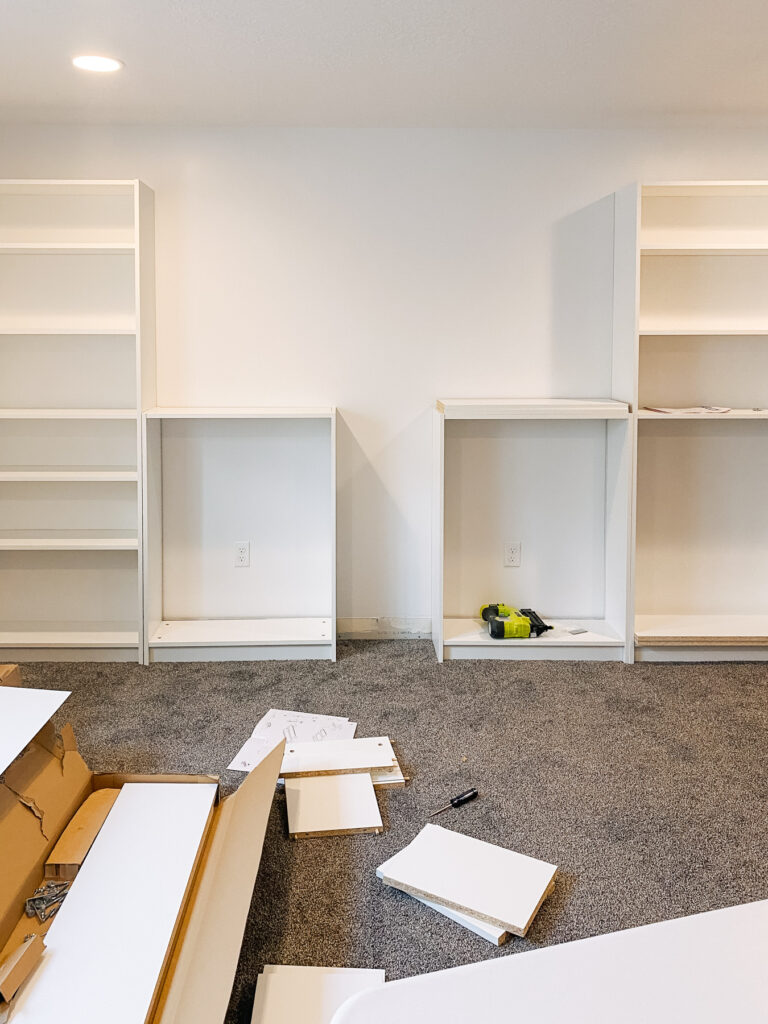 Assembled Billy bookcases against a wall