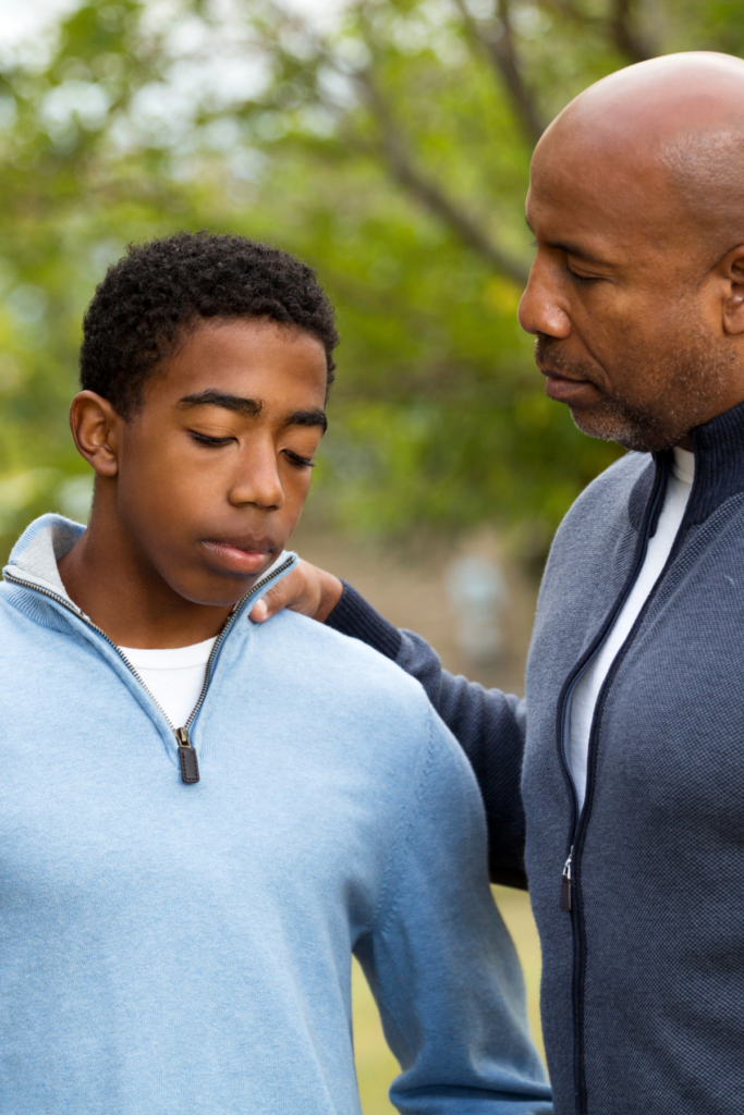 Dad comforts teen after going through a strategic training session.