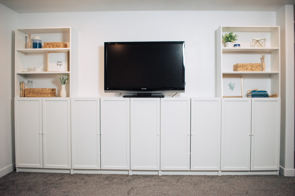 IKEA builtin bookcases in a basement.