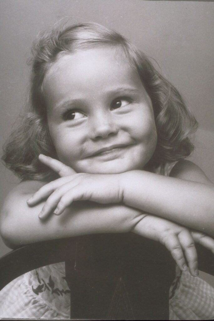Vintage photo of little girl smiling.