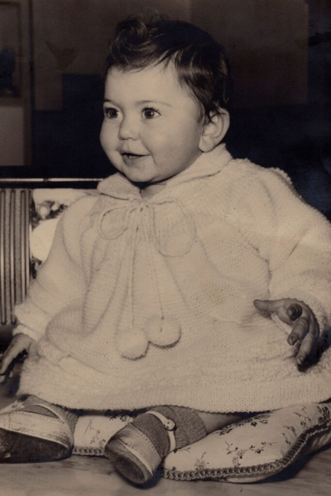 Old fashioned photo of baby girl.