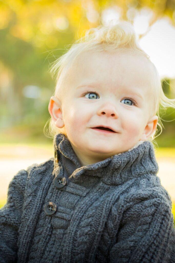 Little boy in blue knit sweater.
