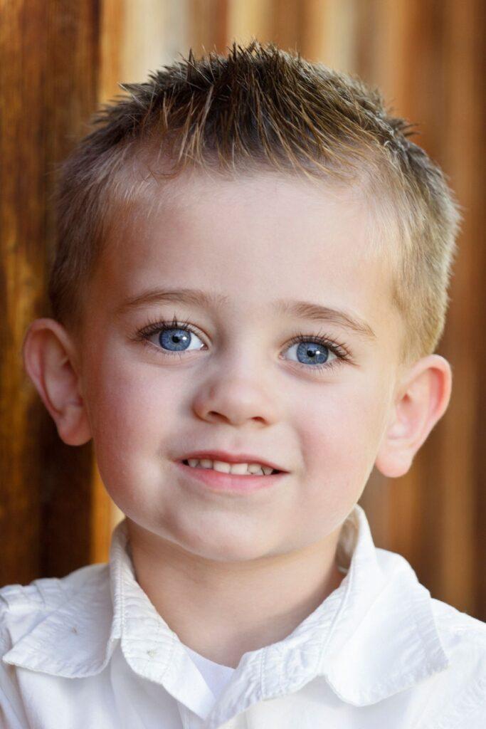 Little boy in white shirt.