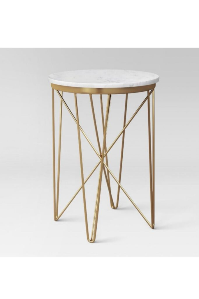 Product photo of gold side table.